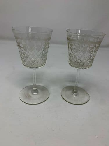 A pair of antique sherry glasses, engraved pattern c1900