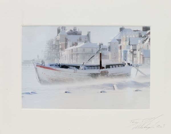 Fishing boats in snow on Aldeburgh beach by Tony Pick
