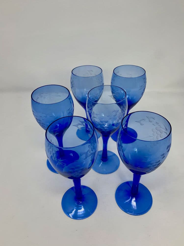 Set of six vintage blue wine glasses with etched grape design
