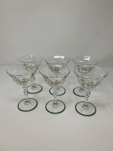 Six beautiful vintage retro tall champagne saucer glasses, with bow and flower motif on the side