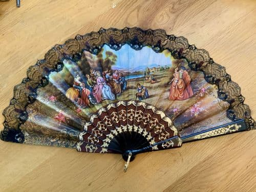 Vintage Cloth Hand fan with a regal scene.