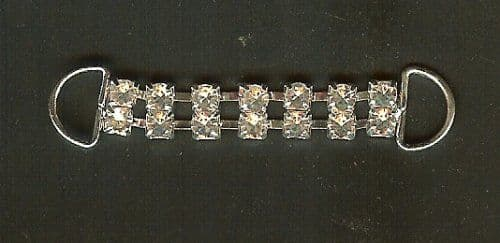 Light weight attractive diamante/rhinestone trim, silver coloured metal mount, with two semi circular loops for attachment. For embellishment on clothing, bags, quilts etc